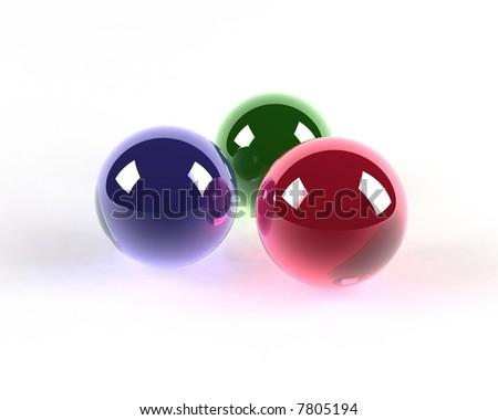 three glass colored spheres - stock photo
