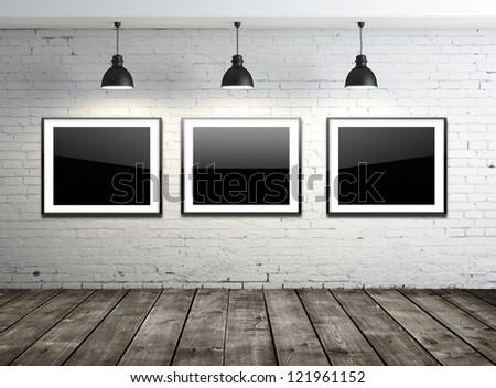three glass frame on brick wall - stock photo