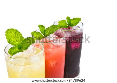Three glass of apple,grape and strawberry juice - stock photo