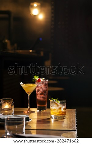 Three glass of cocktail serve on bar table - stock photo