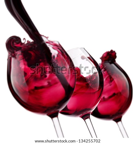 three glass with red wine splash