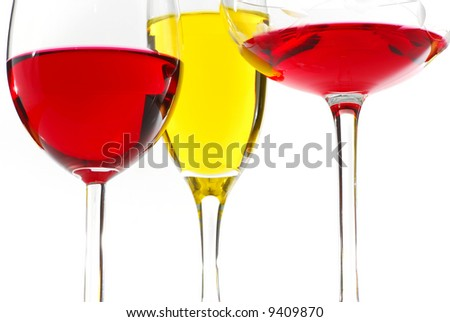 Three glasses filed with wine red and white