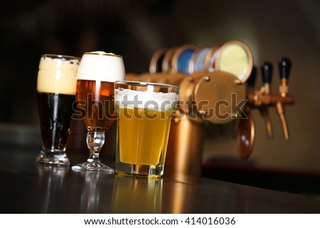 Three glasses of beer in a bar - stock photo