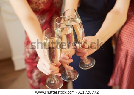 three glasses of champagne close-up women at a party
