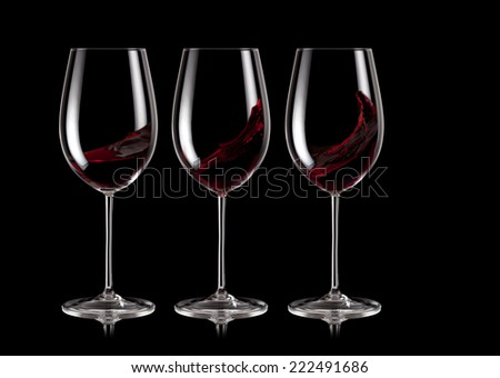 Three glasses of red wine - stock photo