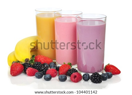 Three glasses of  smoothies with different berries and bananas - stock photo