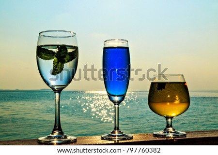 Three glasses of the soft drink. (Maldives, The Indian Ocean)