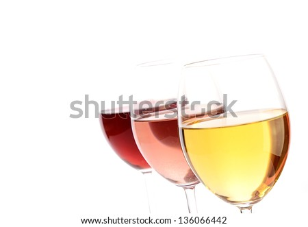 Three glasses of wine on a white background with selective focus on the foreground, space for text on the left
