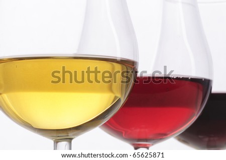 Three glasses of wine, red, rose and white, isolated on white background - stock photo