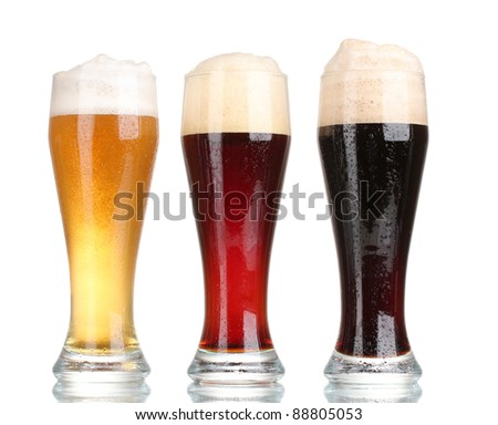three glasses with different beers isolated on white