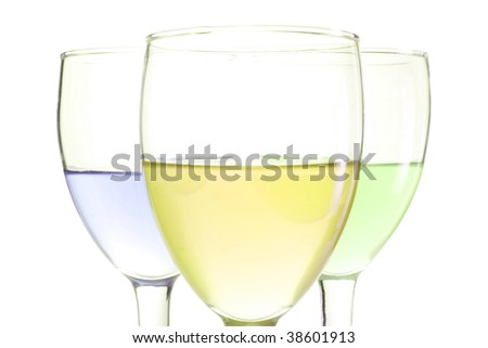 three glasses with green blue and yellow drinks