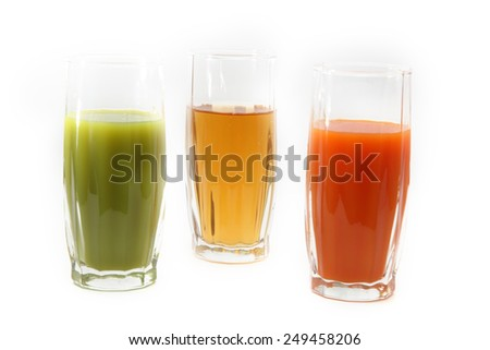 three glasses with juice - stock photo