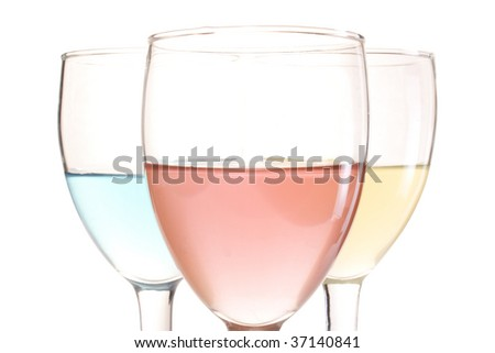three glasses with red blue and yellow drinks