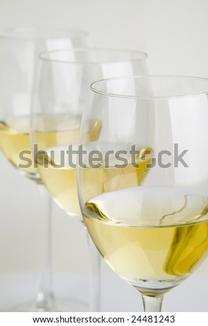 three glasses with white wine - stock photo