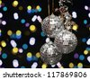 Three glassy ornaments with lights - stock photo