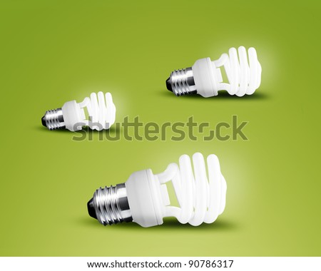 Three glowing Light bulb idea on green background - stock photo