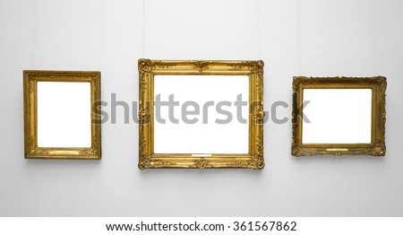 Three gold empty frame on white wall