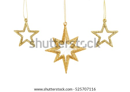 Three gold glitter Christmas stars isolated against white