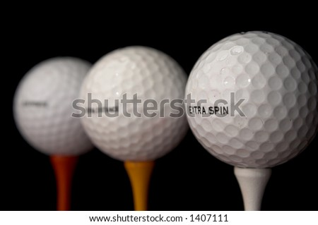 three golf balls - stock photo