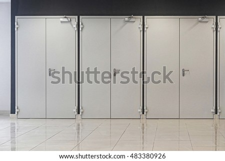 Three gray double doors closed
