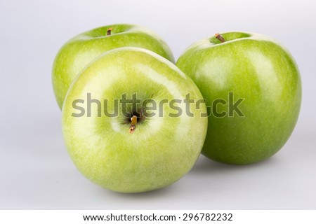 three green apples on white background - stock photo