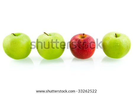 Three green apples with one red apple isolated on white background - stock photo