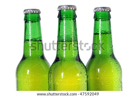 Three green beer bottles isolated on white background -  Selective focus on front bottle