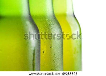 three green beer bottles on the white background isolated - stock photo