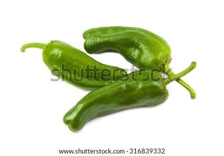 Three green capsicum or sweet pepper on a white background - stock photo