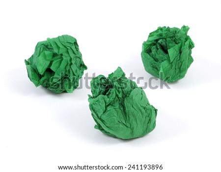 Three green crumpled paper balls on the white background - stock photo