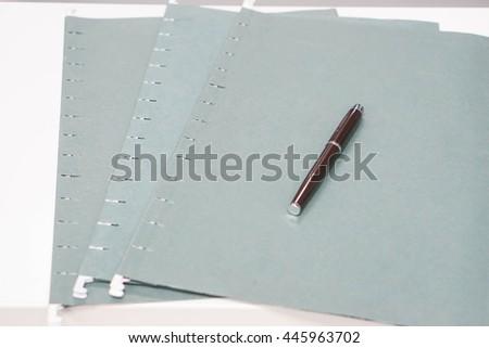 Three green files with a pen for approval - stock photo