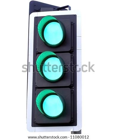 Three Green lights on a traffic pole go - stock photo