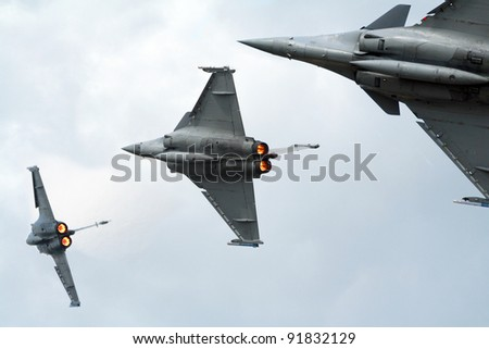 Three grey fighters jets flyby with afterburner