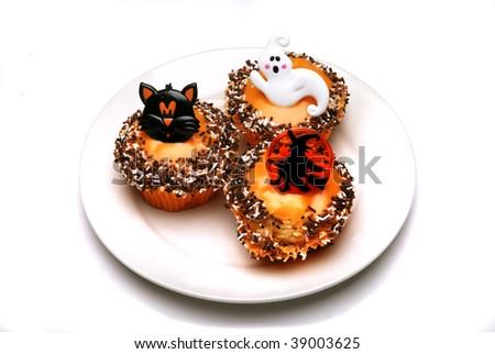Three halloween cakes on a white background - stock photo