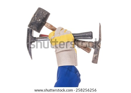Three hammers in the hand - stock photo