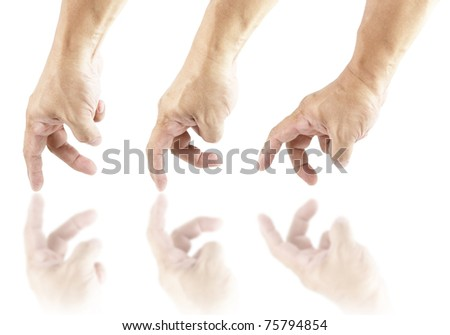 Three hand gliding over a clean white surface with reflection. - stock photo