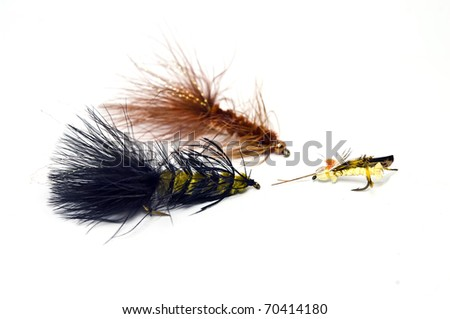 Three hand tied fly fishing lures. - stock photo