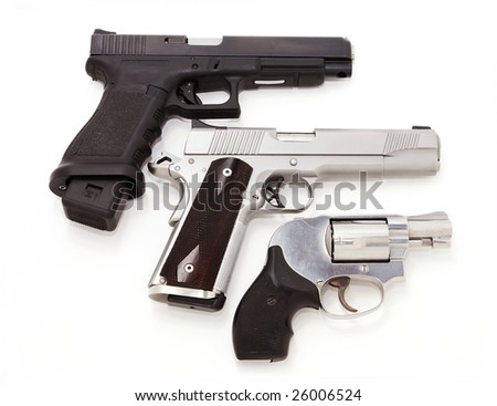Three handguns isolated on white - stock photo