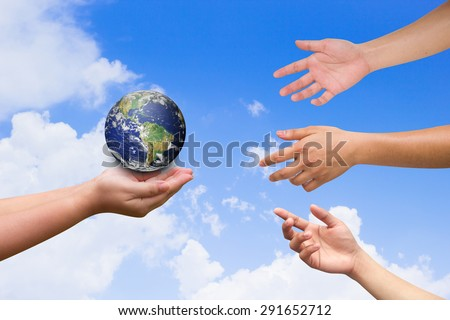 three hands reaching the world for heal together, safe the world concept ,Elements of this image furnished by NASA - stock photo