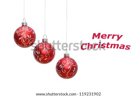three hanging red christmas balls on white background, place for text