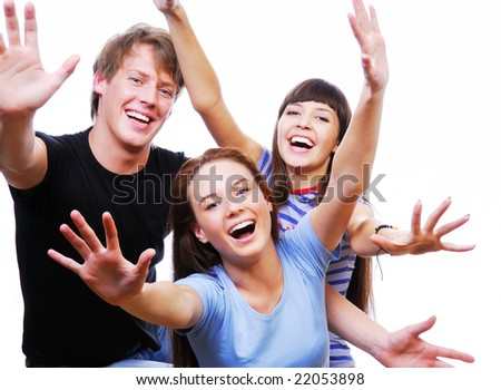 Three happiness teenagers with raised heads . Picture taken from above. - stock photo