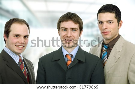 three happy business men together as a team