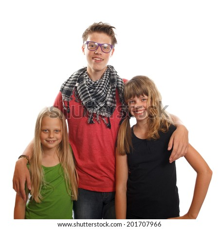 Three happy caucasian siblings standing together and smiling - stock photo