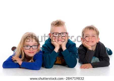 three happy children in front of white background - stock photo
