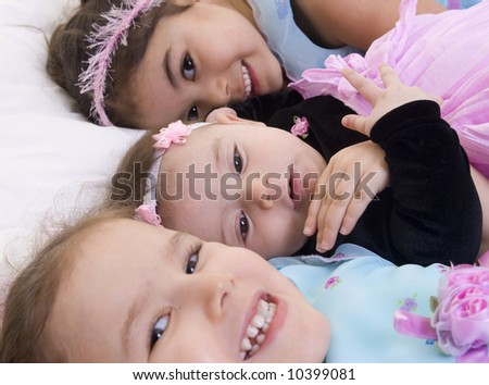 Three Happy children smiling. Bonding, Love, sisters,childhood - stock photo