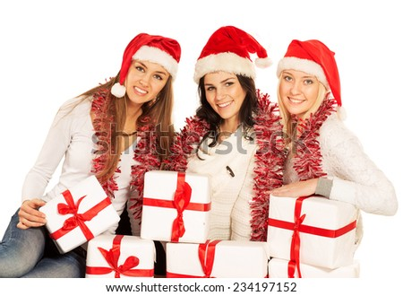 three happy girls with Christmas gifts and decorations