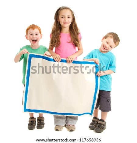 Three happy kids holding blank painted sign. Isolated on white