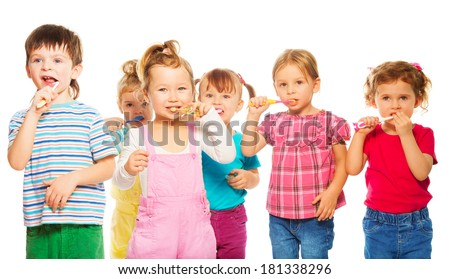 Three happy little 3-4 years old kids group standing with toothpaste - stock photo