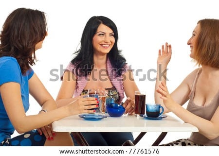 Three happy women friends having a meeting at coffee and having conversation isolated on white background - stock photo