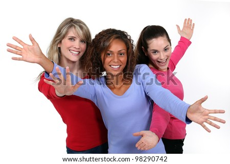 Three happy young woman